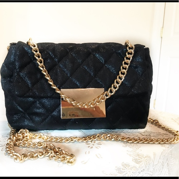 1cff3cc3ef57 AKIRA Handbags - Black quilted purse with gold chain straps